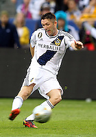 CARSON, CA - DECEMBER 01, 2012:   Robbie Keane (7) of the Los Angeles Galaxy takes a shot against the Houston Dynamo during the 2012 MLS Cup at the Home Depot Center, in Carson, California on December 01, 2012. The Galaxy won 3-1.