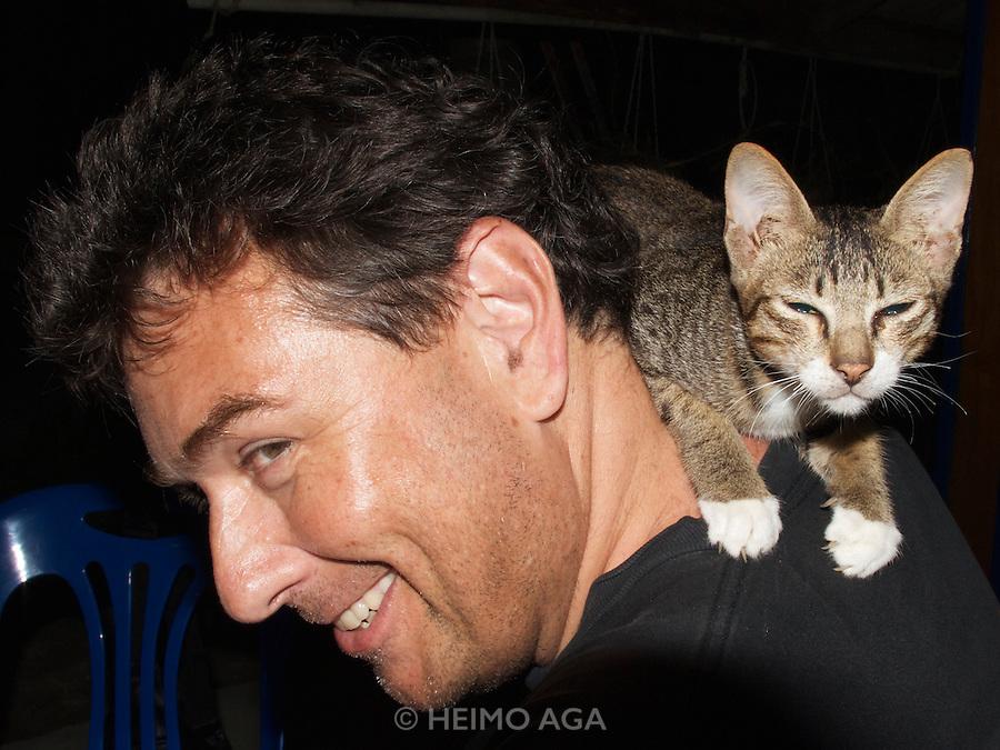 Koh Lipe. Heimo Aga with one of Bundhaya Resort's cats.