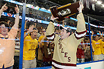 07 APR 2012:  Edwin Shea (8) of Boston College shows off the trophy to the fans after defeating Ferris State University during the Division I Men's Ice Hockey Championship held at the Tampa Bay Times Forum in Tampa, FL.  Boston College defeated Ferris State 4-1 to win the national title.  Matt Marriott/NCAA Photos