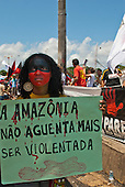 "Belem, Para State, Brazil. Demonstration against the construction of the Belo Monte hydroelectric dam, 20th August 2011. Woman with hand-written sign ""A Amazônia não aguenta mais ser violentada""."