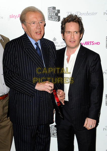 SIR DAVID FROST & TOM HOLLANDER.The South Bank Sky Arts Awards, The Dorchester Hotel, London, England, UK, 25th January 2011..half length black suit jacket white shirt glasses.CAP/CAN.©Can Nguyen/Capital Pictures.