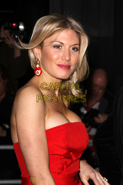 HOFIT GOLAN.'An Evening At Sanderson' at The Sanderson Hotel, London, England..April 27th 2010.half length dress red strapless dangling earrings lipstick cleavage .CAP/AH.©Adam Houghton/Capital Pictures.