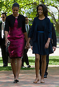 First Lady Michelle Obama and Malia Obama walk across Lafayette Park to attend easter services at St. John's Episcopal Church in Washington, D.C. on Sunday, April 8, 2012. They are accompanied by a detail of Secret Service agents.Credit: Kristoffer Tripplaar  / Pool via CNP