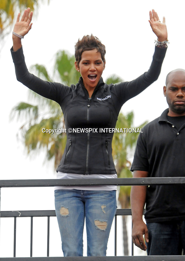 """HALLE BERRY.at the 18th Annual EIF Revlon Run Walk For Women held at the Los Angeles Memorial Coliseum on May 7, 2011 in Los Angeles, California.Mandatory Photo Credit: ©Crosby/Newspix International..**ALL FEES PAYABLE TO: """"NEWSPIX INTERNATIONAL""""**..PHOTO CREDIT MANDATORY!!: NEWSPIX INTERNATIONAL(Failure to credit will incur a surcharge of 100% of reproduction fees)..IMMEDIATE CONFIRMATION OF USAGE REQUIRED:.Newspix International, 31 Chinnery Hill, Bishop's Stortford, ENGLAND CM23 3PS.Tel:+441279 324672  ; Fax: +441279656877.Mobile:  0777568 1153.e-mail: info@newspixinternational.co.uk"""