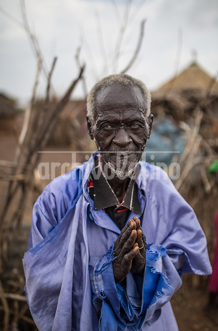 A man in Kakuma refugee camp in Kenya.Kakuma refugee camp in North of Kenya. Kakuma is the site of a UNHCR refugee camp, established in 1991. The population of Kakuma town was 60,000 in 2014, having grown from around 8,000 in 1990. In 1991, the camp was established to host the 12,000 unaccompanied minors who had fled the war in Sudan and came walking from camps in Ethiopia.