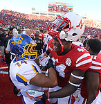 LINCOLN, NE - SEPTEMBER 21, 2013:  WInston Wright #14 of South Dakota State embraces Randy Gregory #44 of Nebraska after their college football game Saturday at Memorial Stadium in Lincoln, NE. (Photo by Dick Carlson/Inertia)