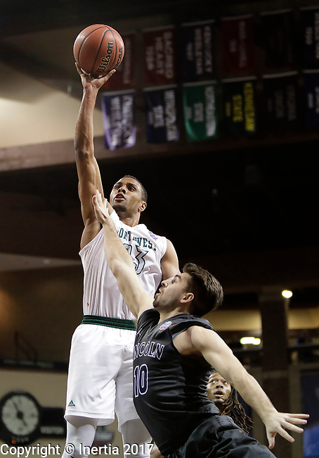 SIOUX FALLS, SD: MARCH 23: Chris-Ebou Ndow #23 of Northwest Missouri State shoots over Hunter Spaw  #10 of Lincoln Memorial during the Men's Division II Basketball Championship Tournament on March 23, 2017 at the Sanford Pentagon in Sioux Falls, SD. (Photo by Dick Carlson/Inertia)