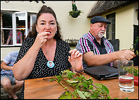 BNPS.co.uk (01202 558833)<br /> Pic: Graham Hunt/BNPS<br /> <br /> Becky Scott competing in the World Nettle Eating Championships at the Bottle Inn, Marshwood, Dorset, UK.