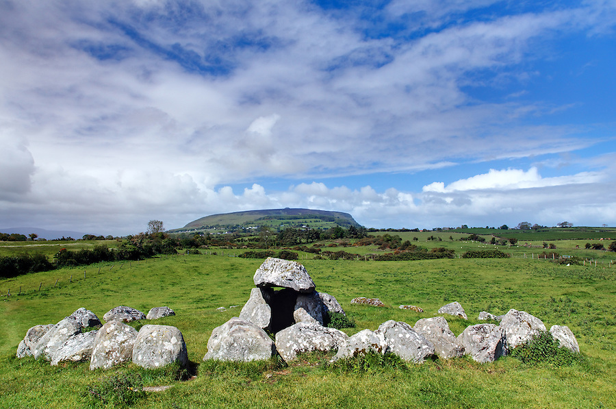 A Carrowmore megalithic tomb in foreground aligned with Queen Maebh's Grave on the top of Knocknarea mountain in background, Carrowmore Megalithic Cemetery, County Sligo, Republic of Ireland