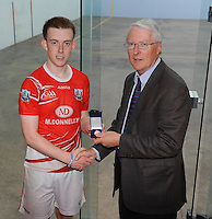 21st September 2013; Willie Roche, president elect of GAA handball, presents  a medal to Daniel Relihan, Cork, after his win in the Minor Doubles Final. GAA Handball, All-Ireland Finals, Broadford Handball Club, Co Limerick. Picture credit: Tommy Grealy/actionshots.ie.