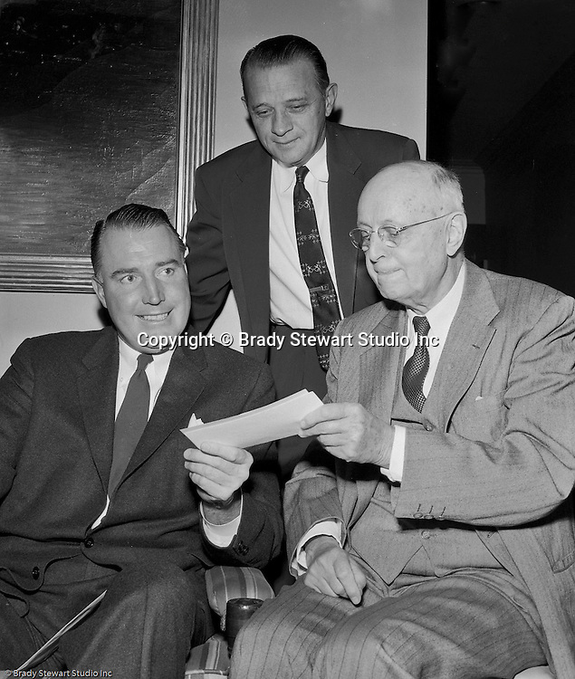 Pittsburgh PA:  View of Fred Bland Jr., receiving checks from a trustee of the Fidelity Trust Company for the annual Caddie Scholarships awarded by the Western Pennsylvania Golf Association 1955.  The Foundation was managed by Fidelity Trust Company and scholarships are agreed upon by the executive committee. The mission of the WPGA are to sanction championships, establish handicapping and rate area golf courses.