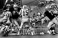 Oakland Raiders against the Boston Patroits, Ben Davidson and Ike Lassiter put the rush on QB Babe Parilli, (1969 photo/Ron Riesterer)