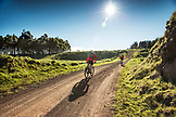 USA, Hawaii, The Big Island, journalist Daniel Duane and chef Seamus Mullens mountain bike on Mana Road at the base of the Kiluea volcano