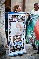 &quot;Hands Off the Children&quot;.<br /> <br /> Graziella Accetta - Mother of Claudio Domino, 11 year-old kid killed by Cosa nostra mafia in 1986 - http://bit.ly/1HVYubB .<br /> <br /> Palermo (Sicily - Italy), 17/07/2017. March of the Agende Rosse, from &quot;Casa di Paolo&quot; to the Faculty of Law at the University of Palermo, to mark the 25th Anniversary of Via D'Amelio bombing where an est. 100kg TNT bomb killed the anti-mafia Magistrate Paolo Borsellino. Also killed by the bomb were five members of Borsellino's police &quot;scorta&quot; (escorts from the special branch of the Italian police force who protect Judges). The police officers were: Agostino Catalano, Emanuela Loi (the first Italian female member of the police special branch and the first one to be killed on duty), Vincenzo Li Muli, Walter Eddie Cosina and Claudio Traina.<br /> <br /> For more info please click here: http://19luglio1992.com &amp; https://www.facebook.com/agenderosse/ &amp; https://en.wikipedia.org/wiki/Via_D%27Amelio_bombing (English Version) &amp; https://it.wikipedia.org/wiki/Strage_di_via_D%27Amelio (Italian Version)