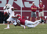 STAFF PHOTO ANTHONY REYES • @NWATONYR<br /> Arkansas cornerback Jared Collins (29) tackles Northern Illinois University receiver Da'Ron Brown in the first quarter Saturday, Sept. 20, 2014 at Razorback Stadium in Fayetteville.