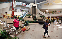 People walk down the stairs in the main atrium of the Valley View Center Mall in Dallas, Texas, Saturday, August 21, 2010. ..MATT NAGER for the Wall Street Journal