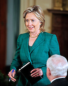 United States Secretary of State Hillary Rodham Clinton arrives for a joint press conference with U.S. President Barack Obama (not pictured) and President Hamid Karzai of Afghanistan (not pictured) in the East Room of the White House in Washington, DC on Wednesday, May 12, 2010..Credit: Ron Sachs / CNP