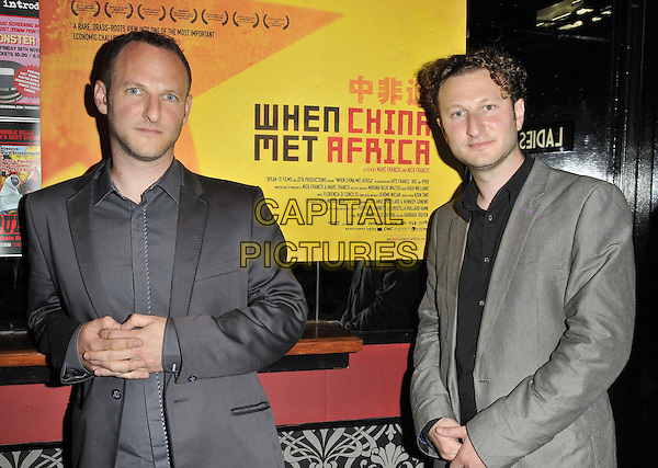Marc Francis & Nick Francis .'When China Met Africa' special screening, Prince Charles cinema, Leicester Place, London, England..9th October 2011.half length black grey gray suit shirt.CAP/CAN.©Can Nguyen/Capital Pictures.