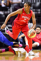 Washington, DC - August 12, 2018: Washington Mystics guard Ariel Atkins (7) steps over a Dallas Wings player after coming up with a loose ball during game between the Washington Mystics and the Dallas Wings at the Capital One Arena in Washington, DC. (Photo by Phil Peters/Media Images International)