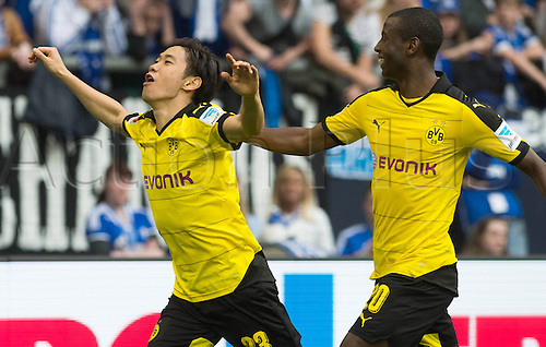 10.04.2016. Gelsenkirchen, Germany. Dortmund's Shinji Kagawa (L) celebrates his goal with teammate Adrian Ramos during the German Bundesliga soccer match between FC Schalke 04 and Borussia Dortmund at the Veltins Arena in Gelsenkirchen, Germany,