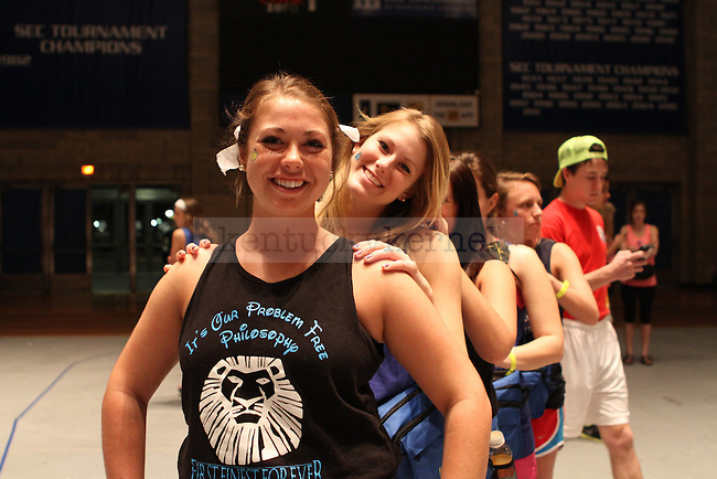 Freshman dietetics major Abby Smith and Sophomore human nutrition major Aubrey Bankemper take a break to join in a message line during DanceBlue, the 24 hour dance marathon, at Memorial Coliseum Saturday February 23th, 2013. Photo by Kirsten Holliday | Staff