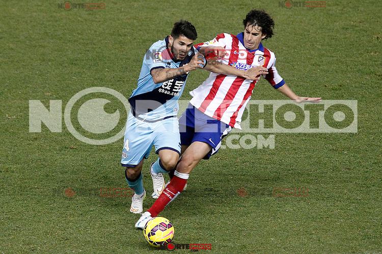 Atletico de Madrid's Tiago Mendes (r) and Rayo Vallecano's Alejandro Pozuelo during La Liga match.January 24,2015. (ALTERPHOTOS/Acero) /NortePhoto<br /> NortePhoto.com