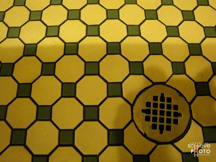 Tile bathroom floor and drain.