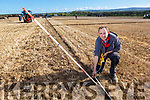 Tommy McCarthy of Abbeydorney measuring and checking the plough ridges at the Abbeydorney Ploughing on Sunday.