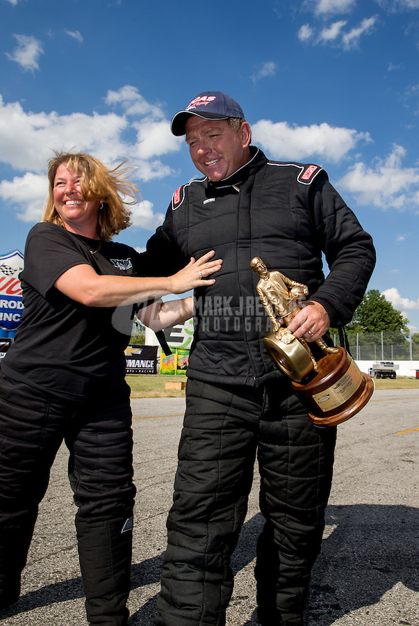 Sept. 2, 2013; Clermont, IN, USA: NHRA top alcohol dragster driver Jim Whiteley (right) celebrates with wife Annie Whiteley after winning the US Nationals at Lucas Oil Raceway. Mandatory Credit: Mark J. Rebilas-