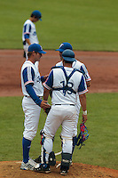 27 july 2010: Pitching coach Jeff Zeilstra talks to Pierrick Le Mestre and Boris Marche during France 8-2 victory over Belgium, in day 5 of the 2010 European Championship Seniors, in Stuttgart, Germany.