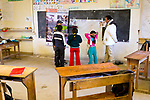 Andean Mountain Cat (Leopardus jacobita) biologists, Alejandra Rocio Torrez Tarqui and Juan Carlos Huaranca Ariste, explaining difference of pampas cats and Andean cats to school children during an educational outreach program, Ciudad de Piedra, Andes, western Bolivia