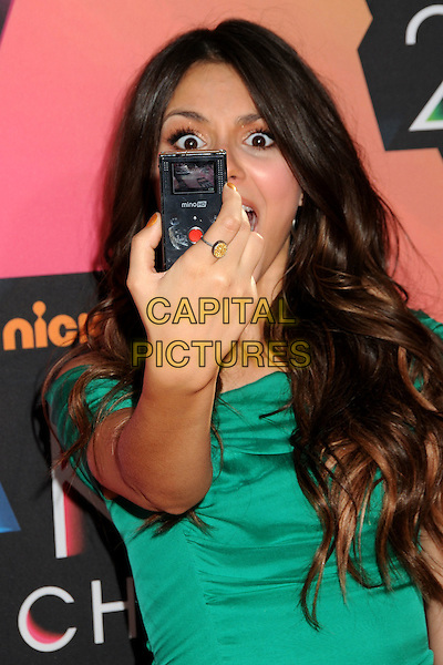 VICTORIA JUSTICE .at the 23rd Annual Nickelodeon Kids' Choice Awards 2010 held at Pauley Pavilion in Westwood, California, USA, March 27th 2010 .arrivals kids half length green hand taking photo camera picture .CAP/ADM/BP.©Byron Purvis/Admedia/Capital Pictures