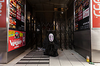 A No-face costume, from the film, Spirited Away, during the  Halloween celebrations Shibuya, Tokyo, Japan. Saturday October 27th 2018. The celebrations marking this event have grown in popularity in Japan recently. Enjoyed mostly by young adults who like to dress up, drink , dance and misbehave in parts of Tokyo like Shibuya and Roppongi. There has been a push back from Japanese society and the police to try to limit the bad behaviour.