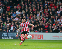Lincoln City's Neal Eardley scores the opening goal for Lincoln City<br /> <br /> Photographer Andrew Vaughan/CameraSport<br /> <br /> The EFL Sky Bet League Two - Lincoln City v Macclesfield Town - Saturday 30th March 2019 - Sincil Bank - Lincoln<br /> <br /> World Copyright © 2019 CameraSport. All rights reserved. 43 Linden Ave. Countesthorpe. Leicester. England. LE8 5PG - Tel: +44 (0) 116 277 4147 - admin@camerasport.com - www.camerasport.com