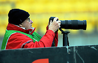 Master photographer Ross Setford reads his emails during the A-League football match between Wellington Phoenix and Perth Glory at Westpac Stadium in Wellington, New Zealand on Sunday, 27 October 2019. Photo: Dave Lintott / lintottphoto.co.nz