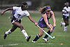 Hannah Arkin #4 of New Hyde Park, right, and Elizabeth Madison #7 of Baldwin battle for possession during a Nassau County Conference I varsity field hockey match at Baldwin High School on Wednesday, Sept. 28, 2016. Baldwin won by a score of 2-0.
