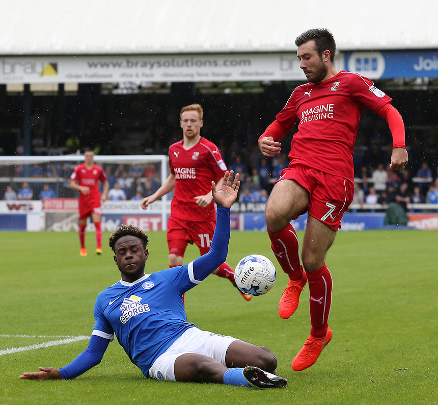 Swindon Town's Michael Doughty is tackled by Peterborough United's Jermaine Anderson<br /> <br /> Photographer David Shipman/CameraSport<br /> <br /> The EFL Sky Bet League One - Peterborough v Swindon Town - Saturday 3 September 2016 -  ABAX Stadium - Peterborough<br /> <br /> World Copyright &copy; 2016 CameraSport. All rights reserved. 43 Linden Ave. Countesthorpe. Leicester. England. LE8 5PG - Tel: +44 (0) 116 277 4147 - admin@camerasport.com - www.camerasport.com