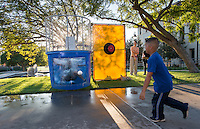 Cassandra Young '15 gets dunked by a child. Occidental College students, their families and alumni enjoy the Tiger Tailgate & Oswald's Carnival in the Academic Quad during Homecoming, Oct. 25, 2014. (Photo by Marc Campos, Occidental College Photographer)