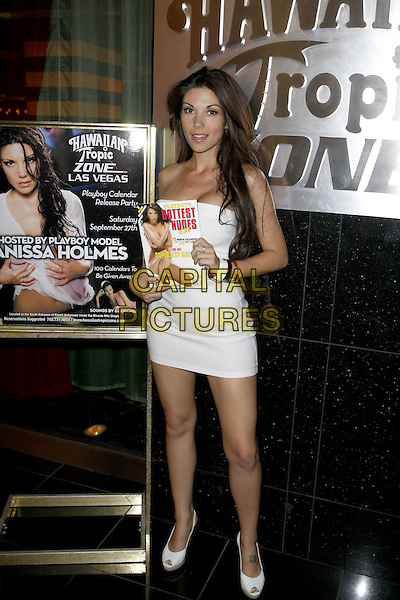 ANISSA HOLMES.Anissa Holmes celebrates the release of the new Playboy Calendar at the Hawaiian Tropic Zone inside the Planet Hollywood Resort Hotel and Casino, Las Vegas, Nevada, USA..September 27th, 2008.full length white strapless mini dress tattoos shoes .CAP/ADM/MJT.© MJT/AdMedia/Capital Pictures.