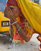 Women taken a drink of Water in the Blue City of  Jodhpur Rajasthan India.