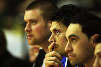 Saints players Calum McLeod, Arthur Trousdell and Reece Cassidy watch from the bench as Heat take a penalty during the National Basketball League match Wellington Saints and Harbour Heat at TSB Bank Arena, Wellington, New Zealand on Saturday 13 June 2009. Photo: Dave Lintott / lintottphoto.co.nz