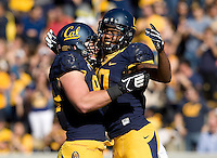 Darius Powe of California celebrates with teammates after scoring a touchdown during NCAA football game against USC at Memorial Stadium in Berkeley, California on November 9th, 2013.   USC defeated California, 62-28.
