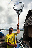 PHILIPPINES, Palawan, Puerto Princessa, fish farm employee Roberto Cabate in the Santa Lucia area
