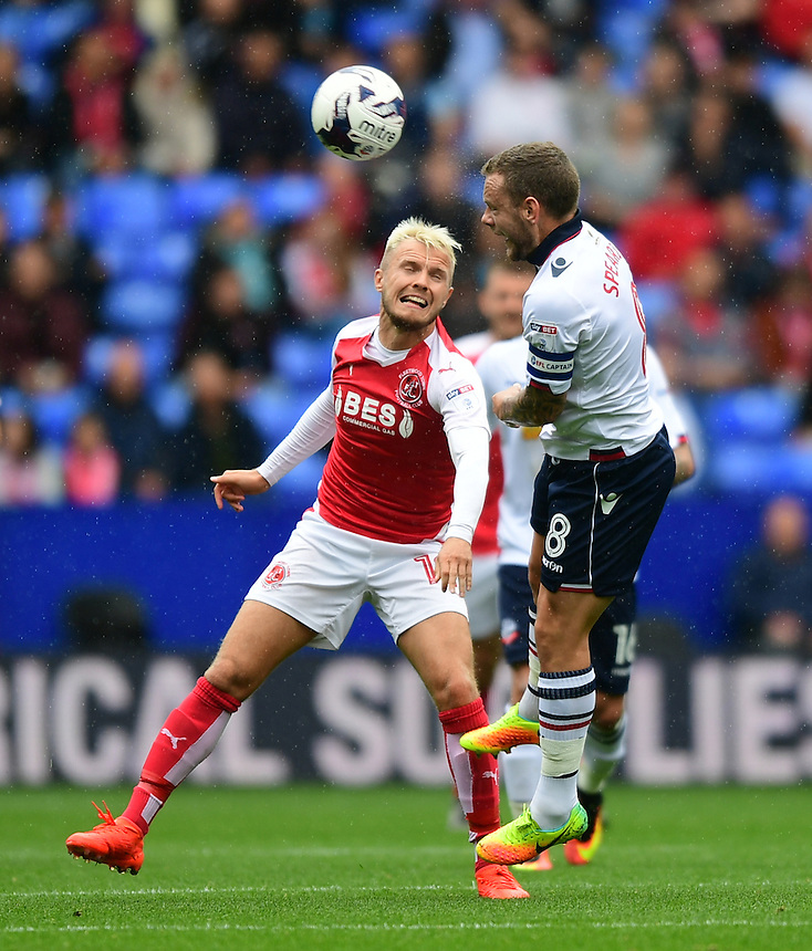 Fleetwood Town's David Ball vies for possession with Bolton Wanderers's Jay Spearing<br /> <br /> Photographer Chris Vaughan/CameraSport<br /> <br /> Football - The EFL Sky Bet League One - Bolton Wanderers v Fleetwood Town - Saturday 20 August 2016 - Macron Stadium - Bolton<br /> <br /> World Copyright &copy; 2016 CameraSport. All rights reserved. 43 Linden Ave. Countesthorpe. Leicester. England. LE8 5PG - Tel: +44 (0) 116 277 4147 - admin@camerasport.com - www.camerasport.com