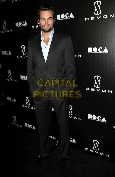 SCOTT ELROD .Grand Opening Of Devon Flagship Store in Beverly Hills held At Devon Store, Beverly Hills, CA, USA, .8th December 2010..full  length black grey gray suit blue shirt hands in pockets .CAP/ADM/KB.©Kevan Brooks/AdMedia/Capital Pictures.
