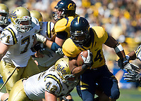September 4, 2010:  Shane Vereen of California fights way through UCLA defense during a game at Memorial Stadium in Berkeley, California.   California defeated UCLA 35-7