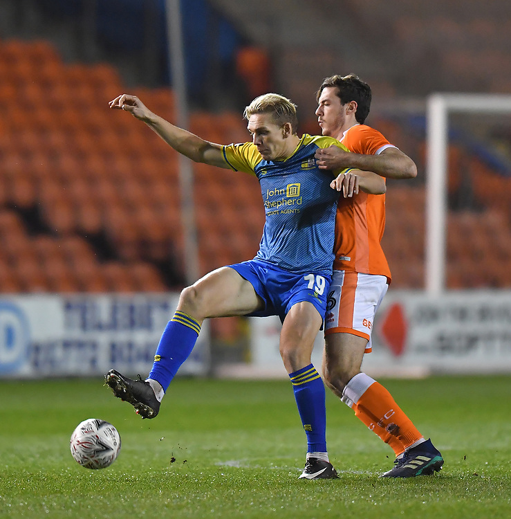 Blackpool's Ben Heneghan battles with Solihull Moors' Danny Wright<br /> <br /> Photographer Dave Howarth/CameraSport<br /> <br /> The Emirates FA Cup Second Round Replay - Blackpool v Solihull Moors - Tuesday 18th December 2018 - Bloomfield Road - Blackpool<br />  <br /> World Copyright © 2018 CameraSport. All rights reserved. 43 Linden Ave. Countesthorpe. Leicester. England. LE8 5PG - Tel: +44 (0) 116 277 4147 - admin@camerasport.com - www.camerasport.com