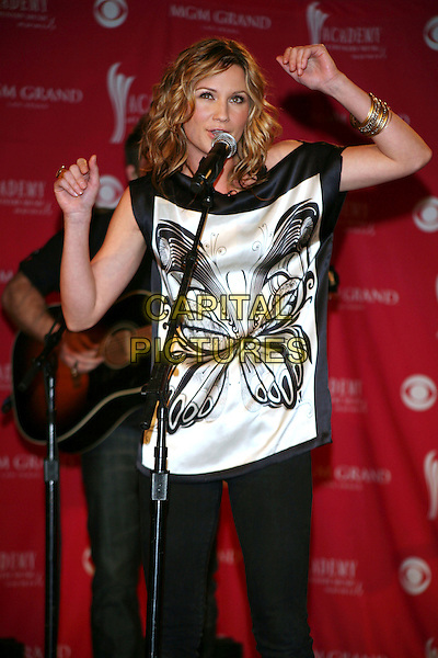 JENNIFER NETTLES of SUGARLAND.announced the 42nd Annual Academy of Country Music Awards Nominees (ACM) held at the Country Music Hall of Fame, Nashville, Tennessee, USA,.5th March 2007..half length black cowboy hat butterfly top singing performing hands arms.CAP/ADM/RR.©Randi Radcliff/AdMedia/Capital Pictures.