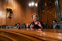 Senator Elizabeth Warren, Democrat of Massachusetts, asks the CFPB Director Kathy Kraninger a question as she testifies before the Senate Banking Committee on Capitol Hill in Washington, D.C. on March 12, 2019. <br /> CAP/MPI/RS<br /> &copy;RS/MPI/Capital Pictures
