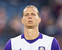 Foxborough, Massachusetts - April 30, 2016:  The New England Revolution (blue and white) tied with Orlando City (purple and white) 2-2 in a Major League Soccer (MLS) match at Gillette Stadium.